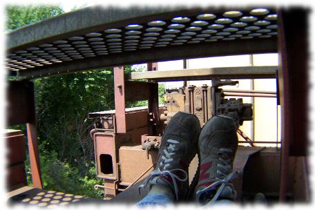 [Photo by Jeff Ferrell: hard travelin' train               hopping. ]